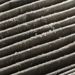 Close up dirty car air conditioner filter isolated on white - deep focus image